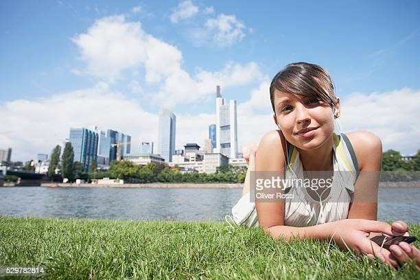 woman lying in grass on riverbank - frankfurt main bildbanksfoton och bilder