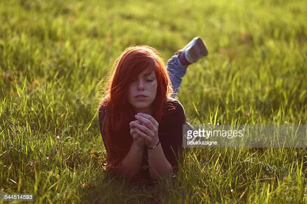 Woman lying in grass