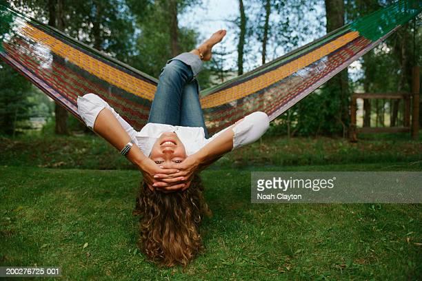 woman lying in hammock, portrait - auf den kopf gestellt stock-fotos und bilder