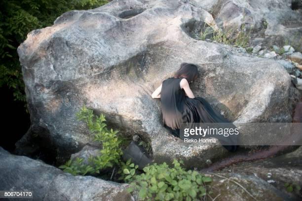 Woman lying on a rock