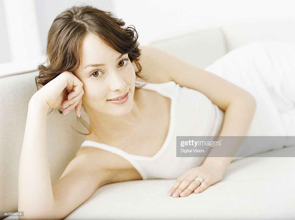 Woman Lying on a Sofa : Stock Photo