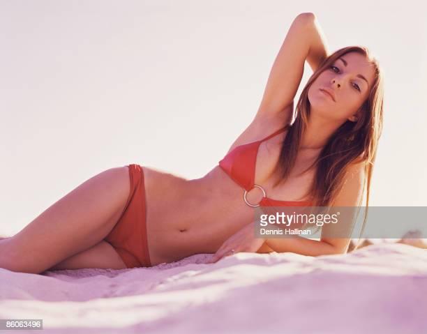 Woman lying on beach in bikini