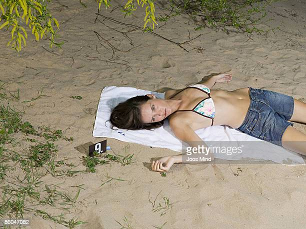 woman lying on beach, murdered - female corpse stock photos and pictures