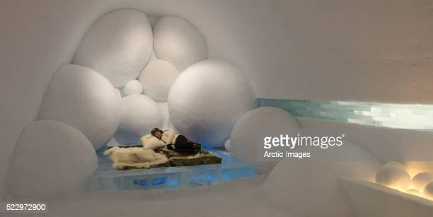 woman lying on bed in icehotel - ice hotel sweden stock pictures, royalty-free photos & images