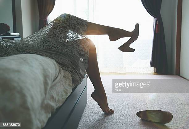 woman lying on bed - japanese women feet stock photos and pictures
