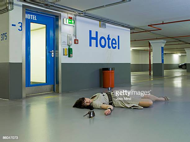 woman lying on car park floor, murdered - gruesome crime scene photos stock pictures, royalty-free photos & images