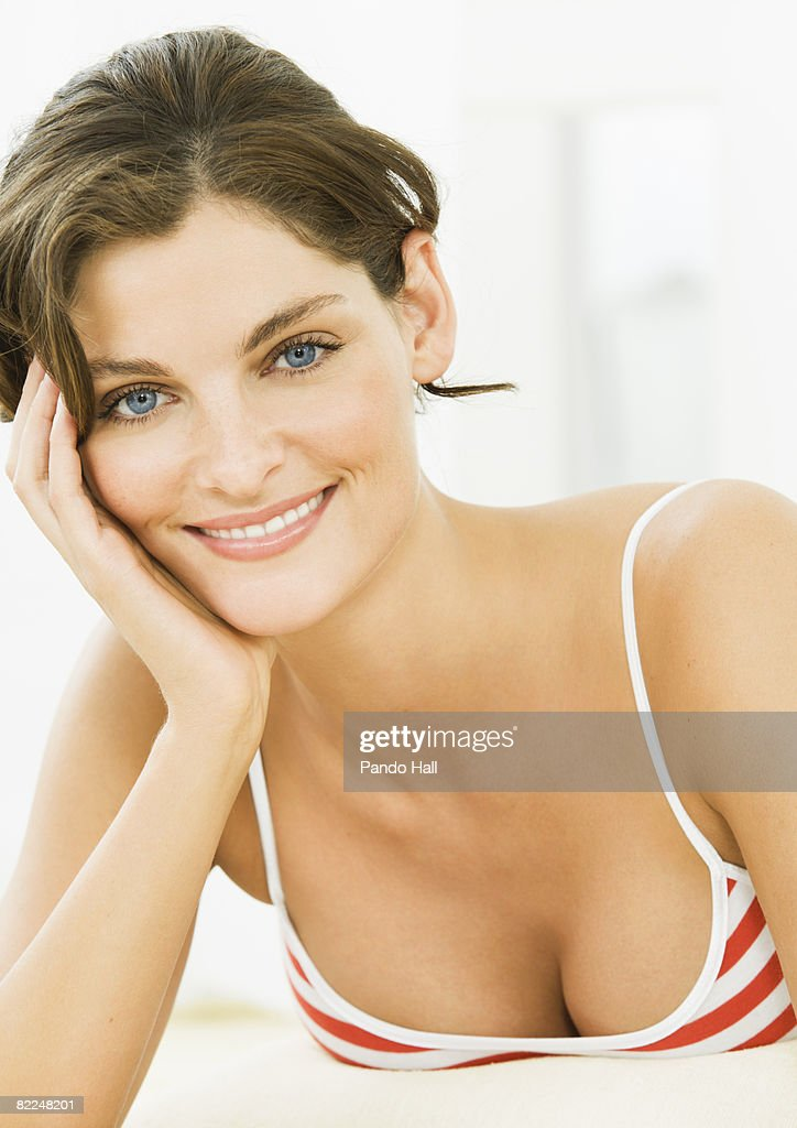 Woman lying on carsmiling, head on hand, portrait : Stock Photo