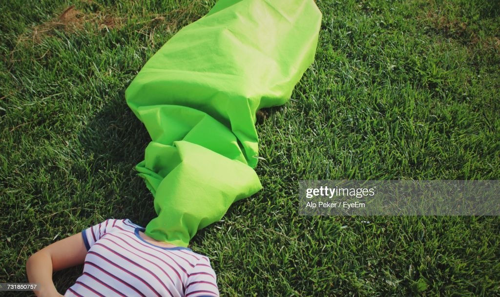 Woman Lying On Field : Stock Photo