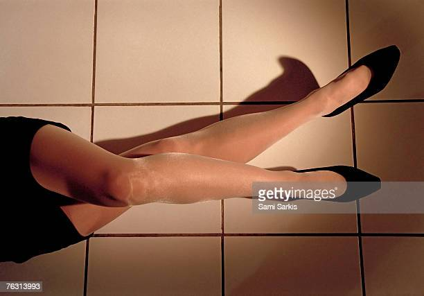 woman lying on floor, low section, high angle view - short skirts and stockings stock photos and pictures