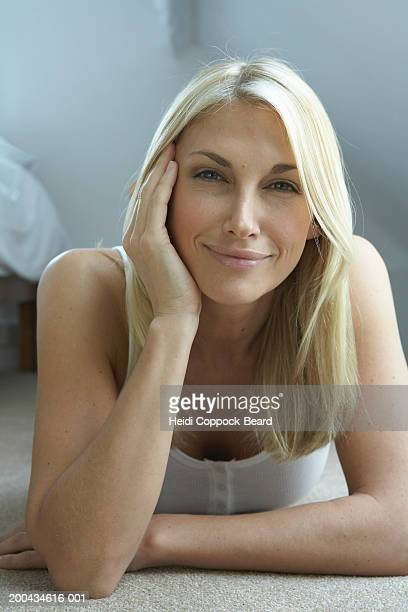 woman lying on floor, smiling, portrait, close-up - heidi coppock beard bildbanksfoton och bilder