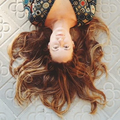 Woman lying on floor with hair arranged - gettyimageskorea