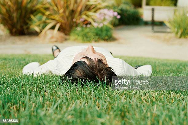 woman lying on grass - jessamyn harris stock pictures, royalty-free photos & images