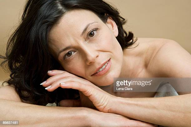 A woman lying on her front relaxing