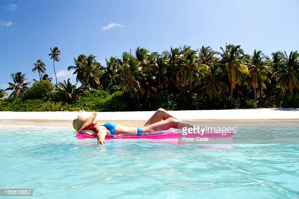 woman lying on inflatable in sea
