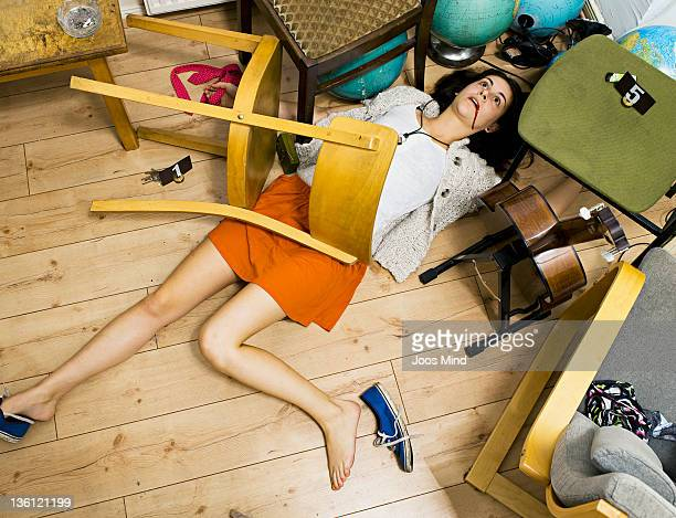 woman lying on living room floor, murdered - murdered women stock pictures, royalty-free photos & images