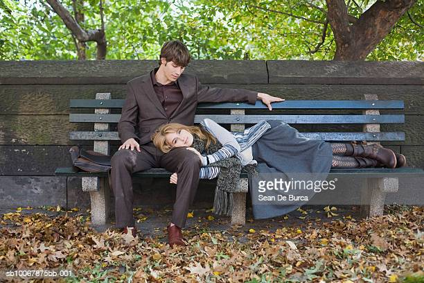 Woman lying on man's lap at park