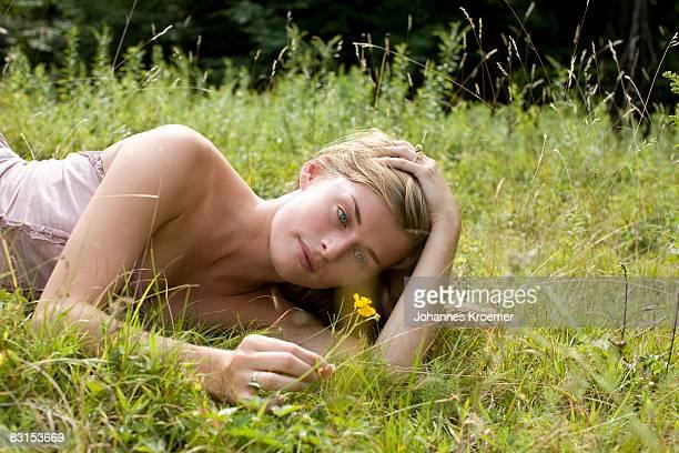 woman lying on meadow