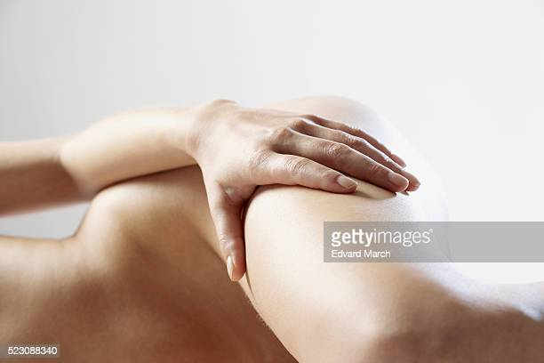 Woman lying on side with hand on her leg