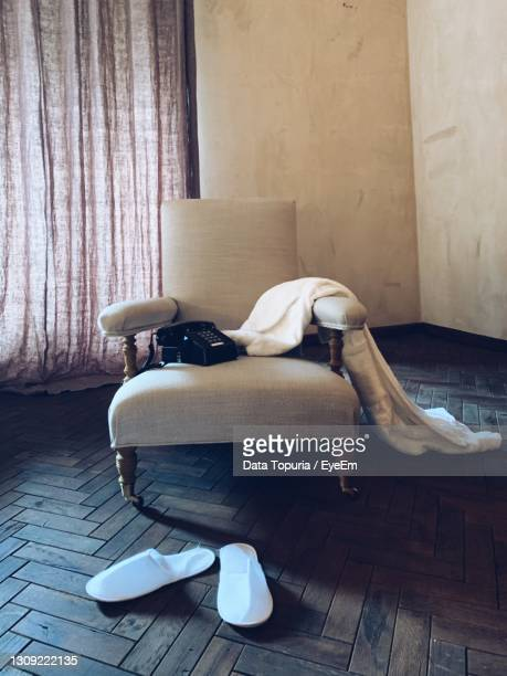 woman lying on sofa at home - data topuria stock pictures, royalty-free photos & images