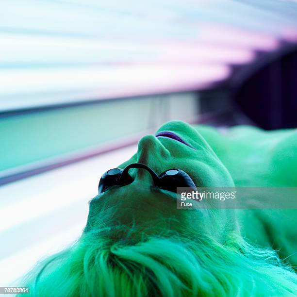 Woman Lying on Tanning Bed