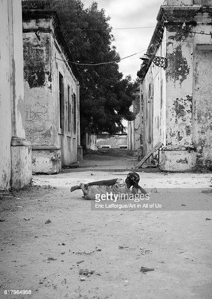 Woman lying on the ground inside the old hospital, island of mozambique, Mozambique on July 18, 2013 in Island Of Mozambique, Mozambique.