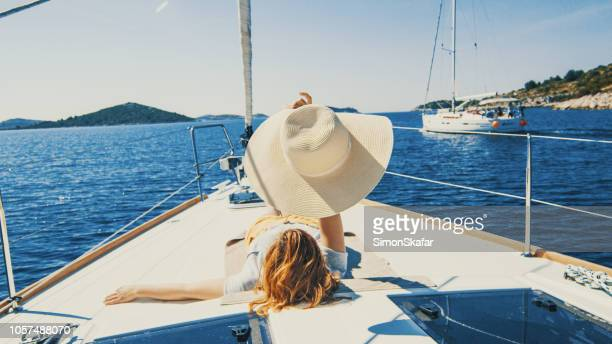 woman lying on yacht deck - adriatic sea stock pictures, royalty-free photos & images