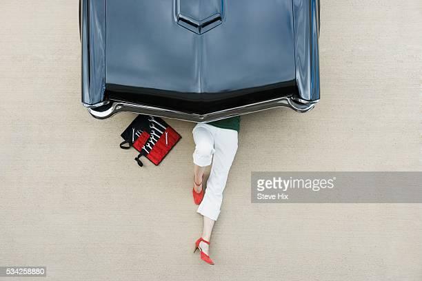 Woman Lying Under Car