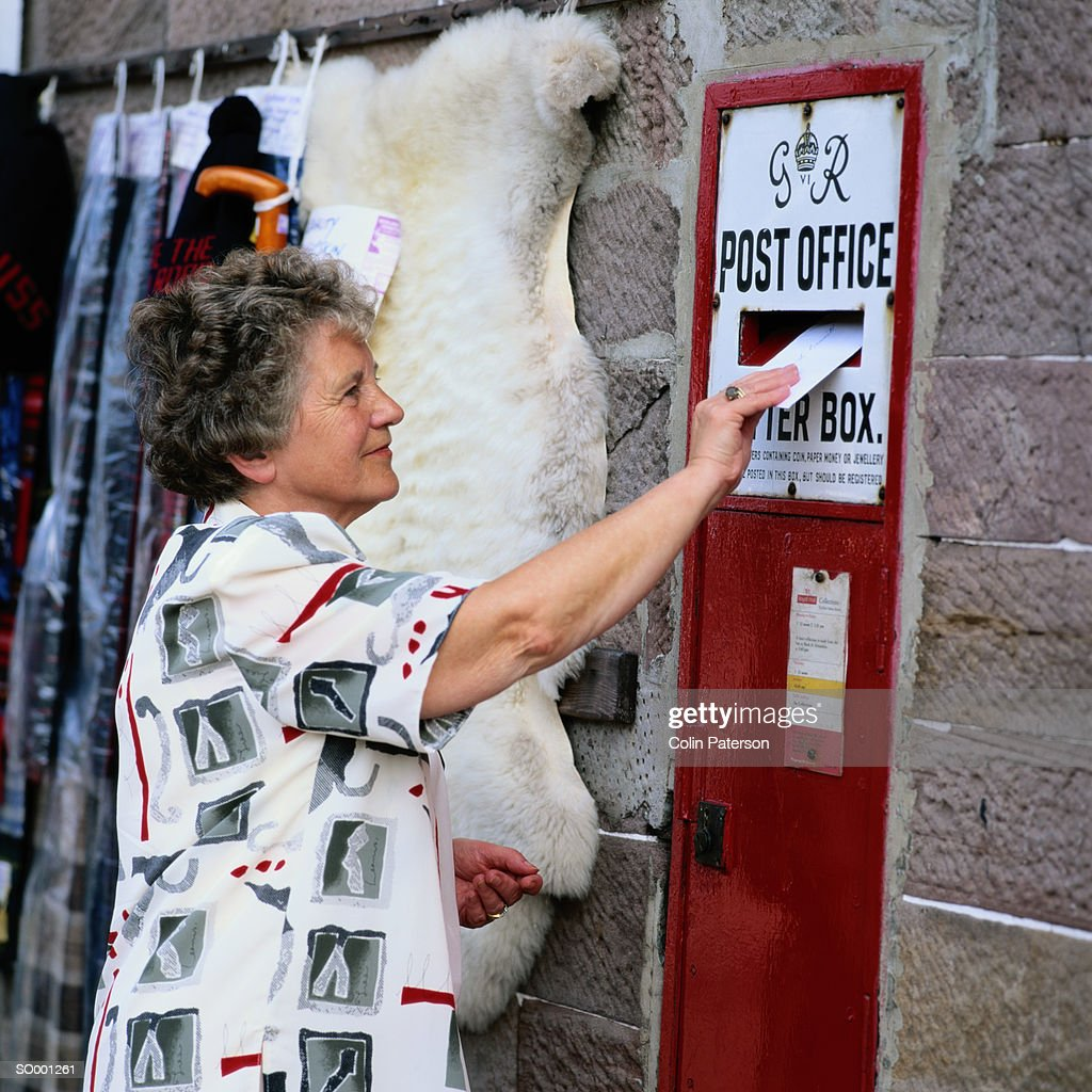 Woman Mailing A Letter Stock Photo  Getty Images