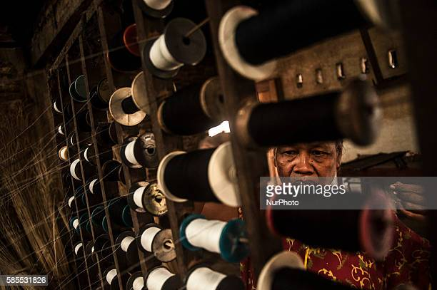 A woman make handicraft weaving in Gemplong Yogyakarta Indonesia on Auguts 3 2016 The weaving craft can be made tablecloths bags and slippers with a...