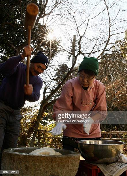 Woman make rice cakes Mochi for celebrations of the forthcoming Year of the Dragon at Zuiganji temple on December 28 2011 in Himeji Japan The...