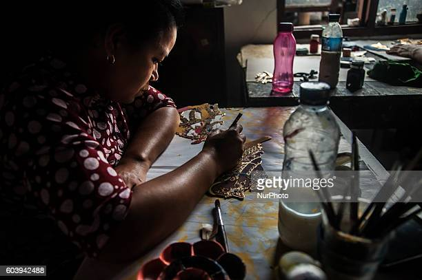 A woman make shadow puppet known as ' wayang ' in Yogyakarta Indonesia on September 7 2016 Shadow puppet has been recognized as a world cultural...