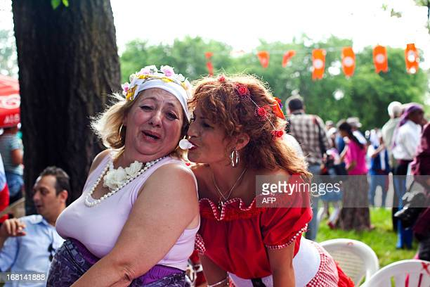 A woman makes a bubble with her chewing gum as Turkish gypsies celebrate the annual Spring Festival 'Hidirellez' on May 5 2013 in Edirne southwestern...