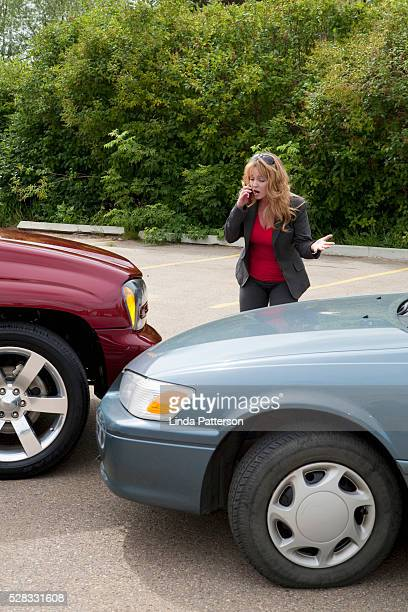 A Woman Makes A Phone Call For Help After She Gets Into A Car Accident; Edmonton, Alberta, Canada