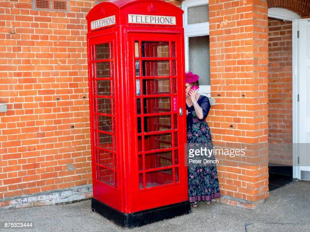 A woman makes a phone call next to a classic red British telephone box at Royal Ascot One of Britain's most wellknown racecourses Ascot holds a...