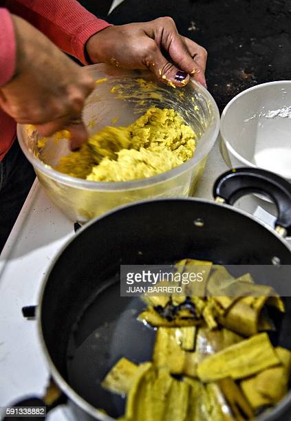 A woman makes 'arepas' in Caracas on 16 August 2016 Pumpkin and beetroot arepas plantain peels pretending to be shredded meat Venezuelans are...