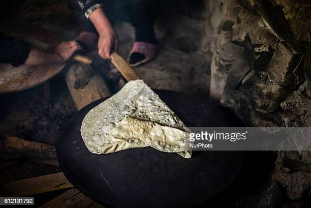 A woman makes bread in the kitchen of her house in Khinalig village Quba region Azerbaijan Traditional bread for this village is lavash very thin...