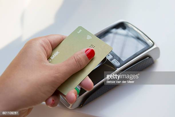 Woman makes contactless payment using creditcard