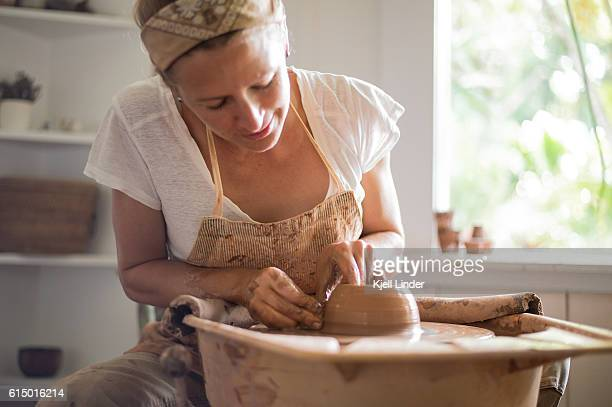 Woman makes hand made ceramics from clay I
