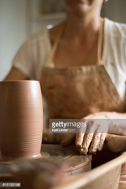 Woman makes hand made ceramics from clay IV