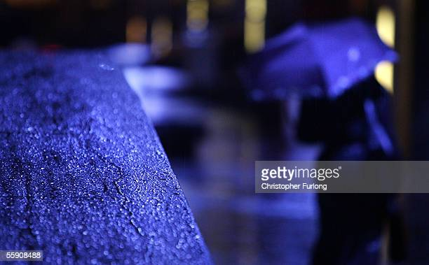 Woman makes her way home through the incessant on October 10, 2005 Glasgow, Scotland. Seasonal affective disorder , or winter depression, is a mood...