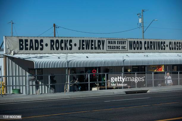 Woman makes her way past one of many stores along Main St. In Quartzsite, Arizona. Quartzsite is a town that grows thrice over in these winter months...