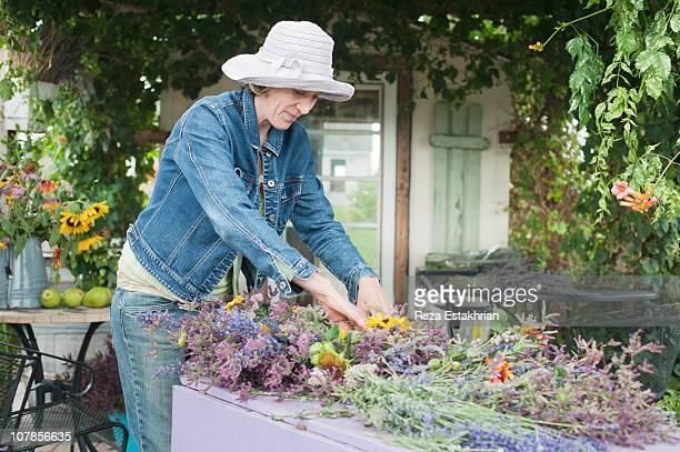 Woman makes herbal wreath