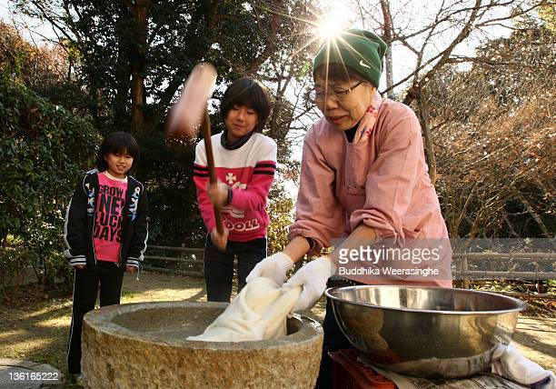 A woman makes rice cakes Mochi for celebrations of the forthcoming Year of the Dragon at Zuiganji temple on December 28 2011 in Himeji Japan The...