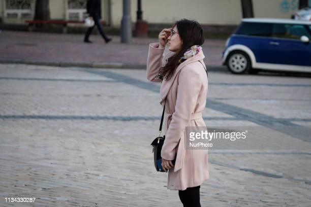 A woman makes the sign of the cross upon leaving Saint Michael's Monastery in Kyiv Ukraine on April 1 2019