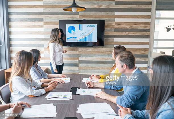 woman making a business presentation - projection screen stock pictures, royalty-free photos & images