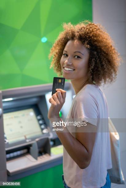 Woman making a cash withdrawal on an ATM