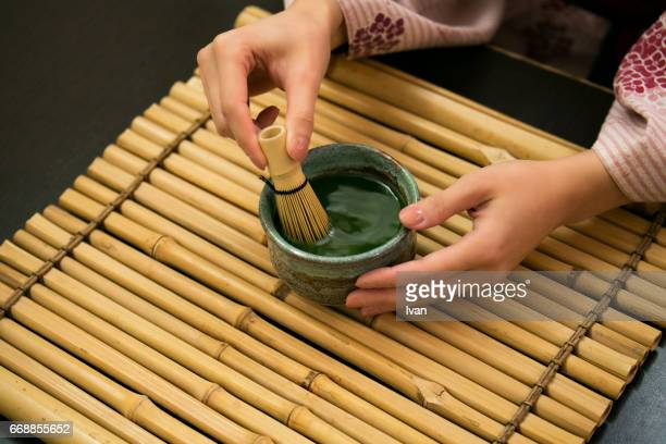 A Woman Making a Cup of Japanese Matcha, Green Tea