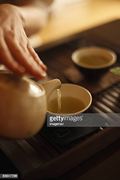 A woman making a cup of tea
