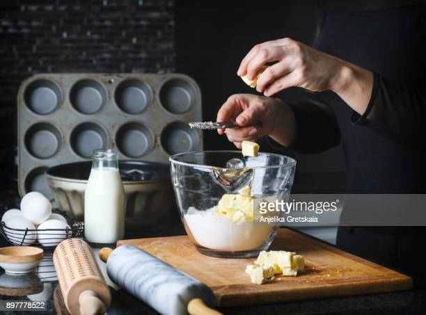 Woman making a flaky pastry dough