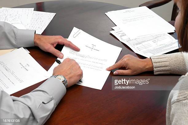A woman making a formal business agreement signing a will